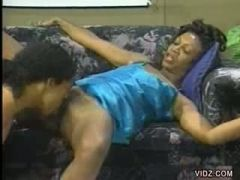 Ebony chick scarfs down on lengthy brown cock
