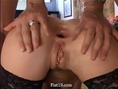 Tight analhole fisting on the table