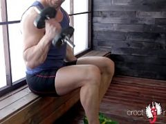 One of naked sportsmen with big uncut cock after hard workout