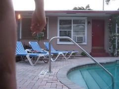 Jerking naked by the hotel pool