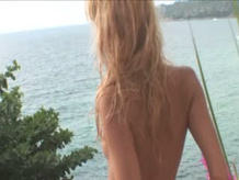 Blond posing naked on the terrace